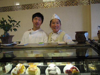 Proprietor and chef Hiang Hwa Yong (Wei Wei) with son Thomas